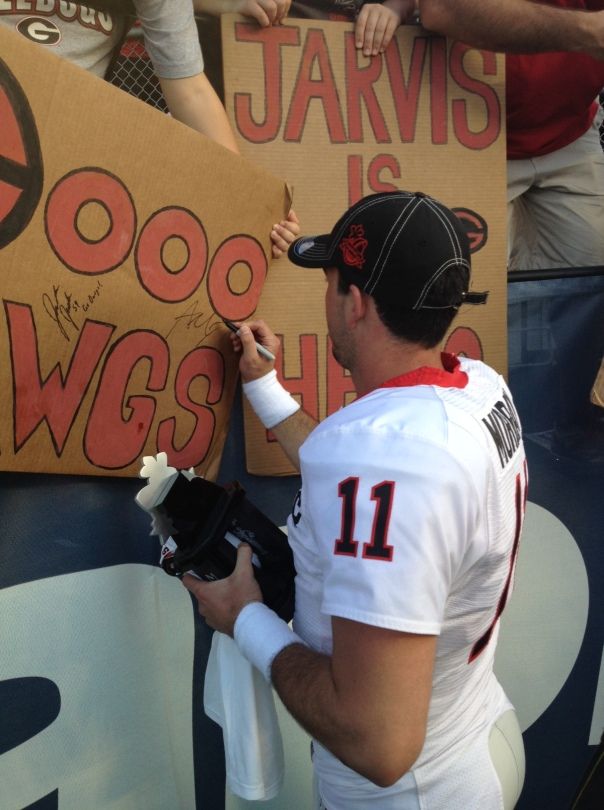 Aaron Murray signs a poster following the 2013 Capital One Bowl.