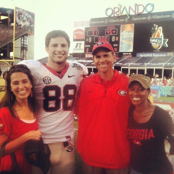 Another great memory from last season -bowl win. Hey, how did @alynch1788 get to stand beside my wife? #1stWinIn2013
