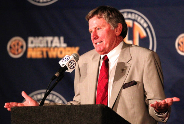 Steve Spurrier opened SEC Media Days by wearing a face that matched his own tie.  Via.