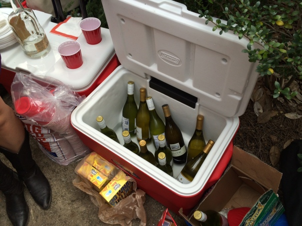 For those who think LSU fans smell like corndogs, you might or might not be right.  But, we did find one classy Tiger tailgate with a cooler full of wine.