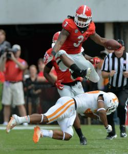 Todd Gurley hurdles Tennessee defensive back Brian Randolph Saturday. (Brant Sanderlin / AJC)